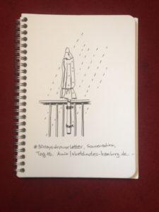 Tag 16, Sonnenschirm (Schirm zusammengefaltet im Regen).. Zeichnung und Foto: Ania Groß